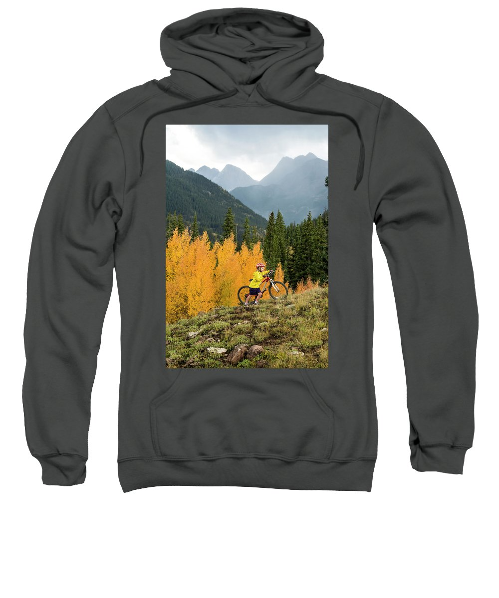 Forest Sweatshirt featuring the photograph A Young Girl Mountain Biking In The San by Kennan Harvey