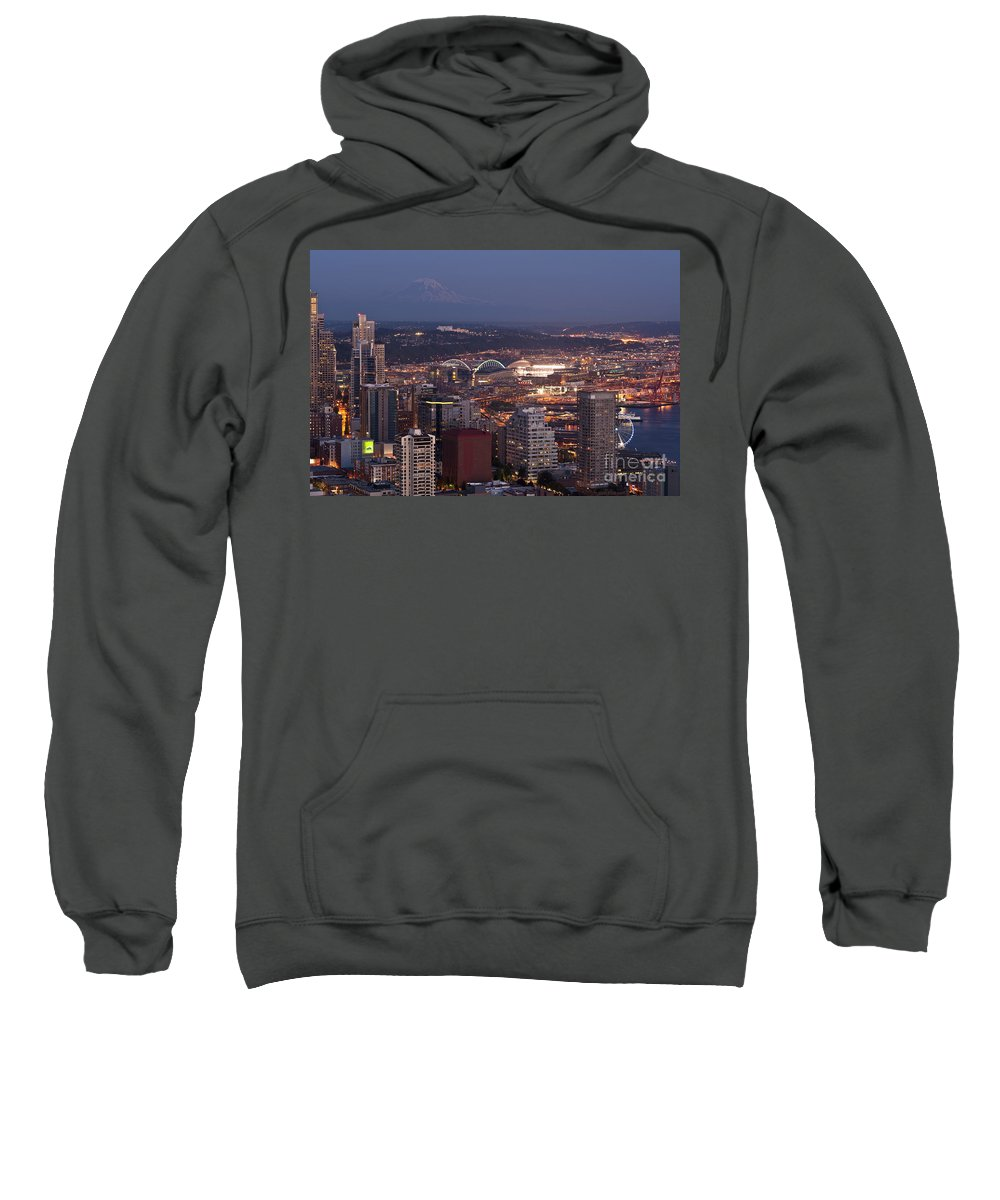 Elliott Bay Sweatshirt featuring the photograph Seattle Skyline With Mount Rainier And Downtown City Lights by Jim Corwin