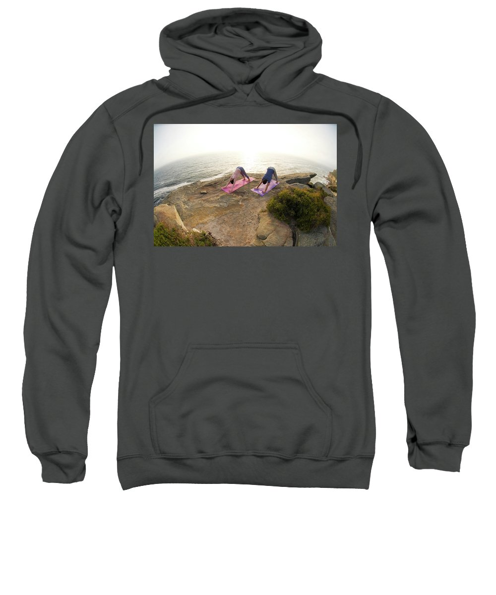 Australia Sweatshirt featuring the photograph A Man And Woman Practicing Yoga by Lars Schneider