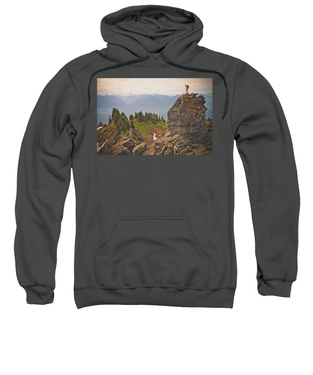 One Mid Adult Man Only Sweatshirt featuring the photograph A Backpacker Balances On The Blocky by Christopher Kimmel