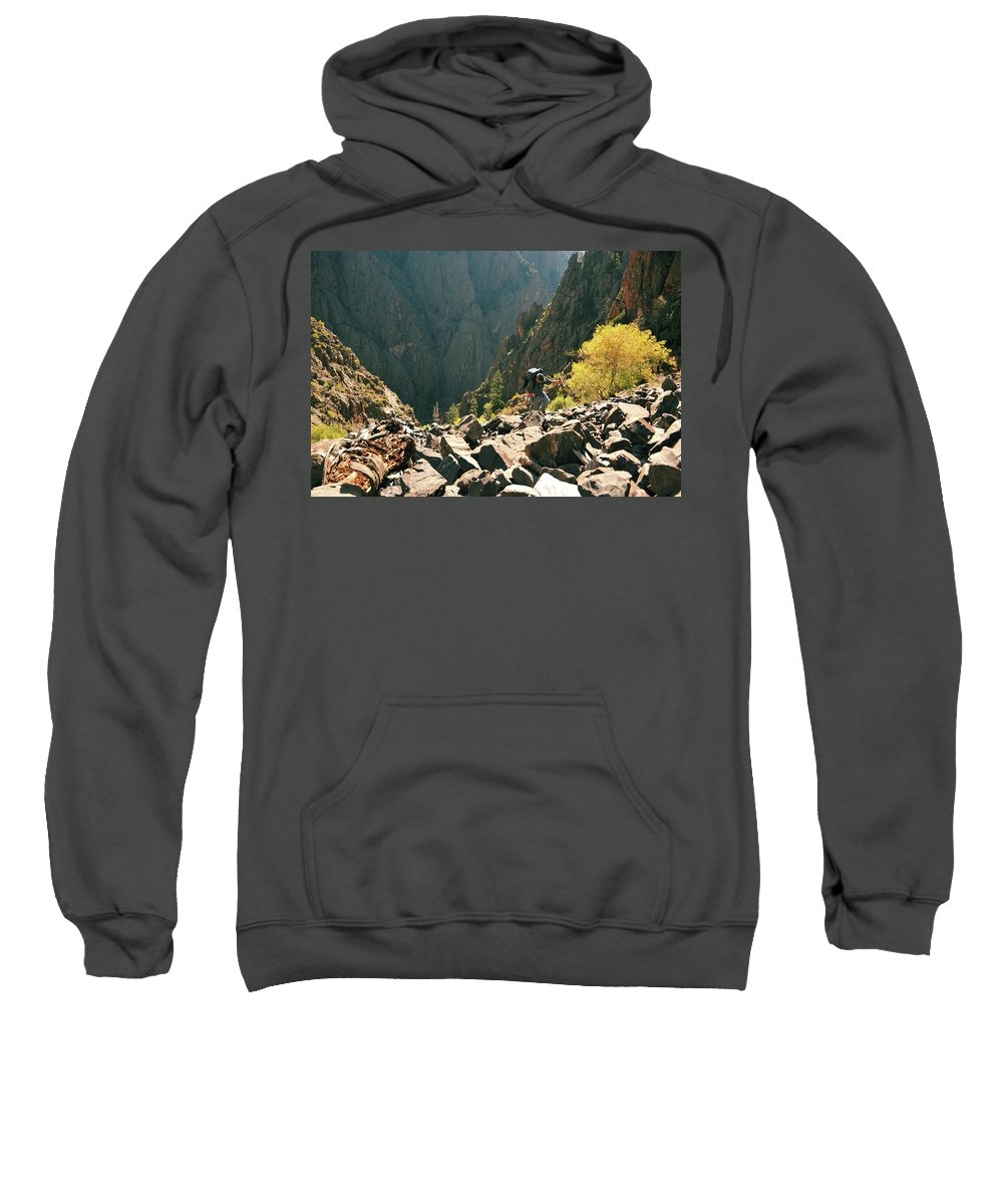 Backpack Sweatshirt featuring the photograph A Man Navigates A Rock Scree Field by Bud Force