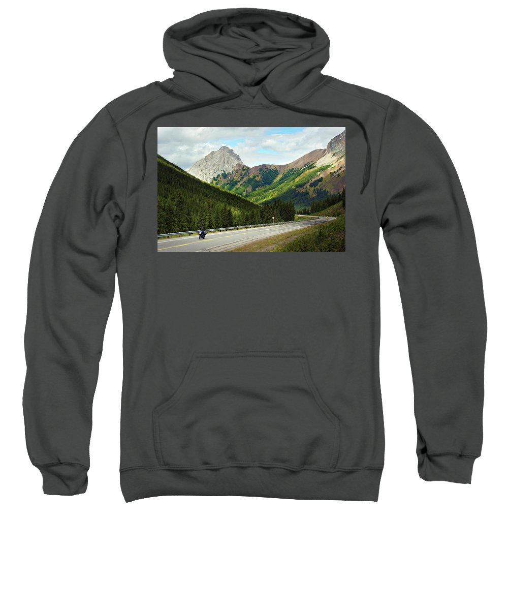 Alberta Sweatshirt featuring the photograph A Motorcyclist Enjoys An Open Stretch by Todd Korol