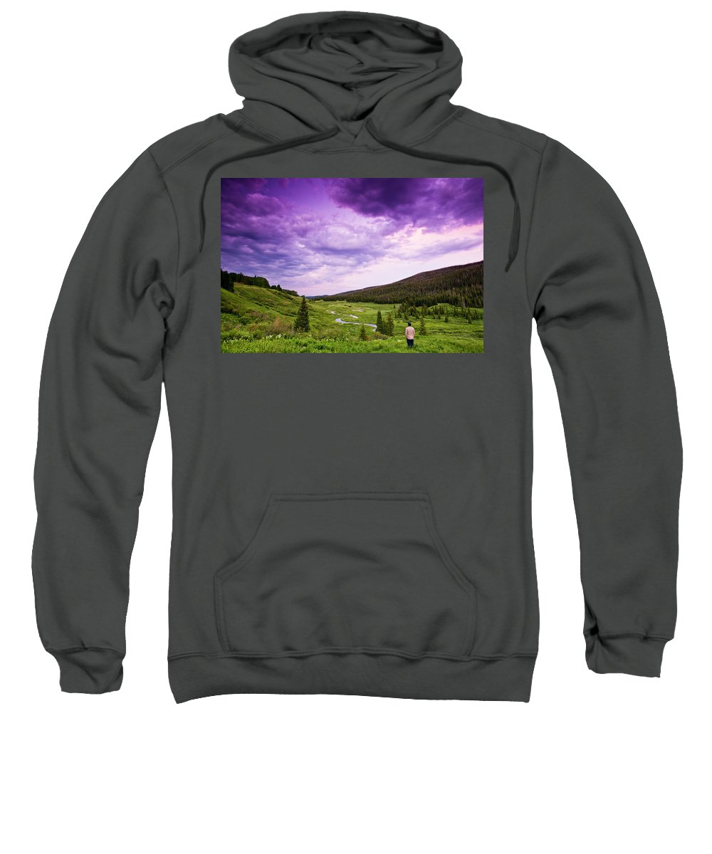 Leisure Activity Sweatshirt featuring the photograph A Person Stand In A Field Watching by Rob Hammer