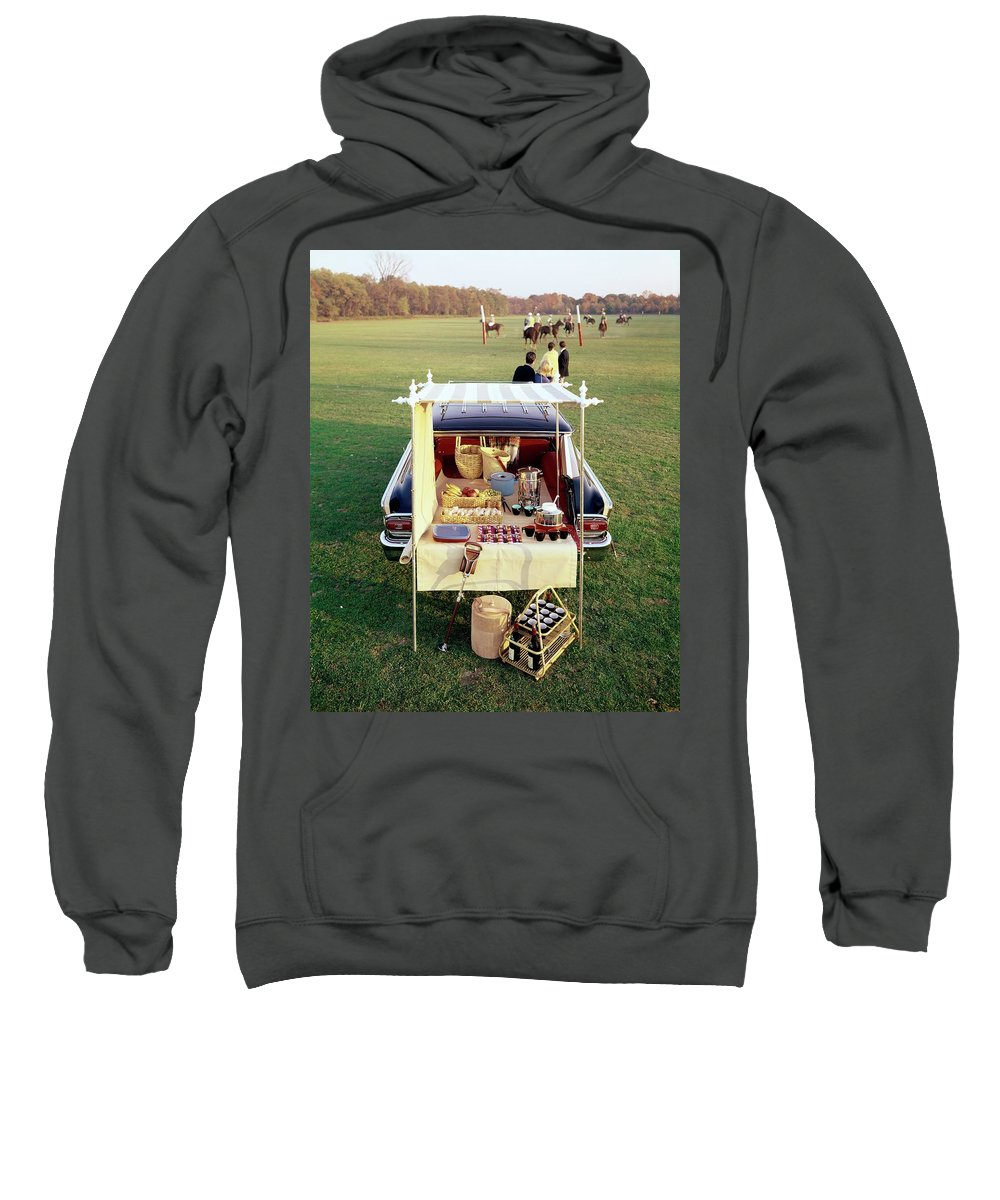 Food Sweatshirt featuring the photograph A Picnic Table Set Up On The Back Of A Car by Rudy Muller