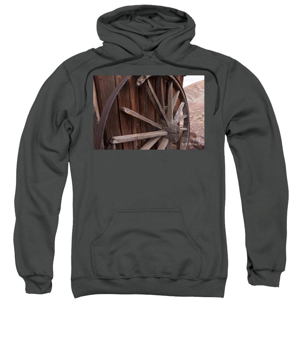 Abandoned Sweatshirt featuring the photograph Abandoned Wagon Wheel by Dan Hartford