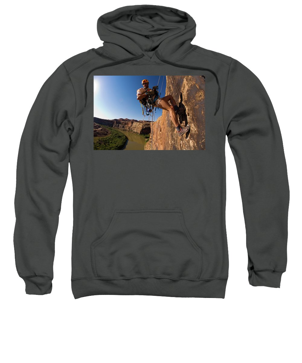 Action Sweatshirt featuring the photograph Adventure Racer Rappelling Over A River by Corey Rich