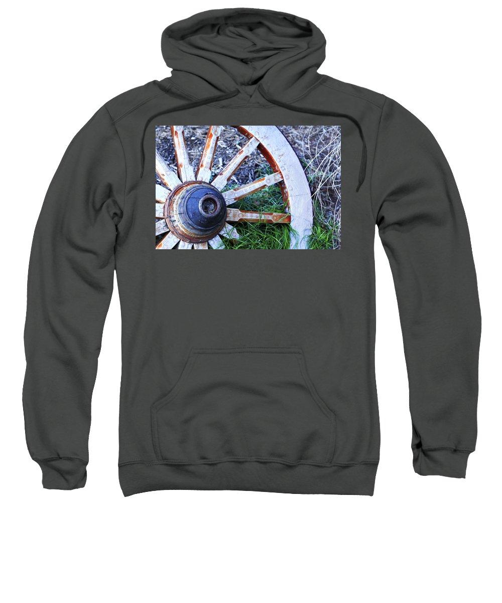 Americana Sweatshirt featuring the photograph Artful Wagon Wheel by Marilyn Hunt