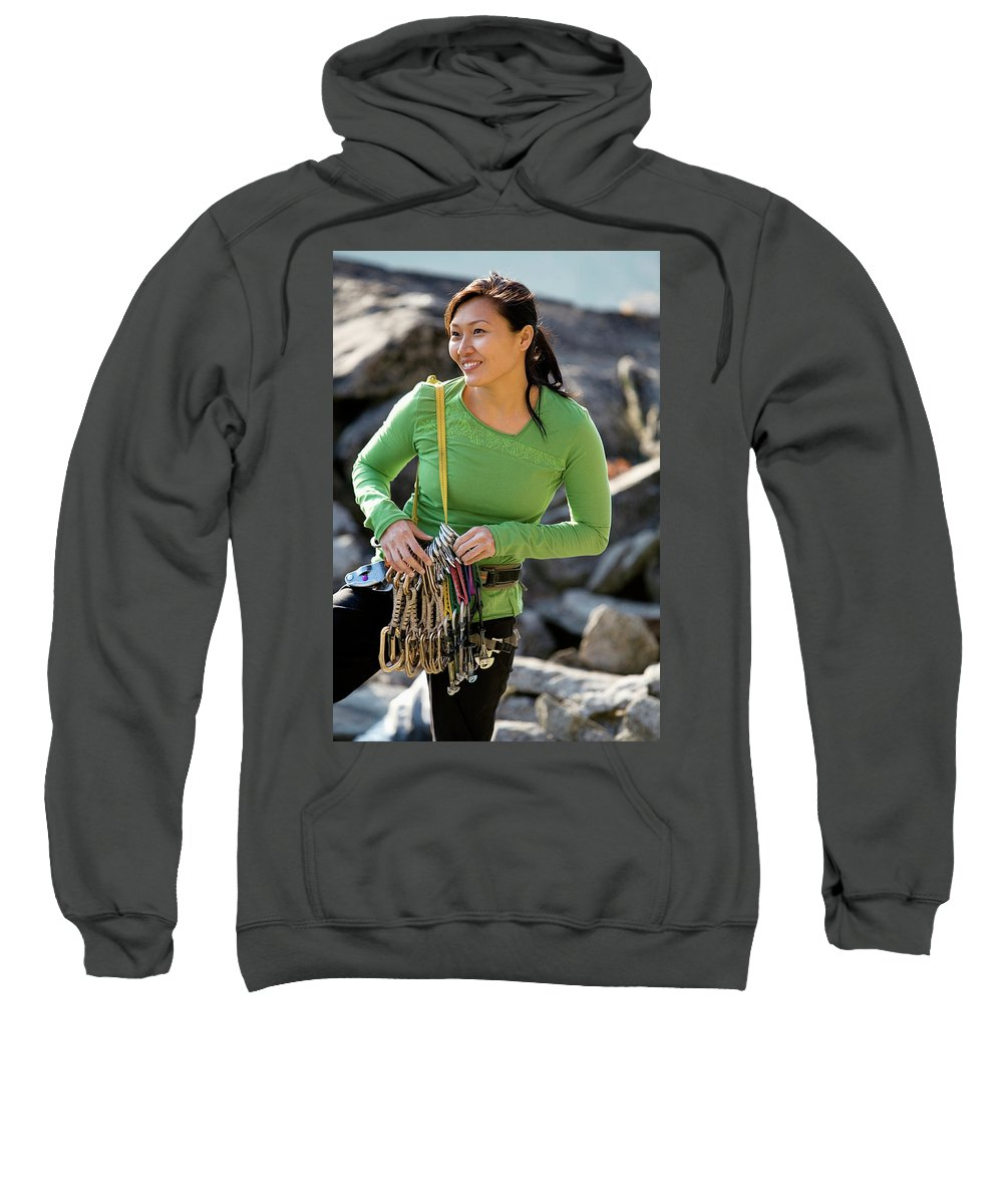Adult Sweatshirt featuring the photograph Attractive Female Climber Adjusting by Corey Rich