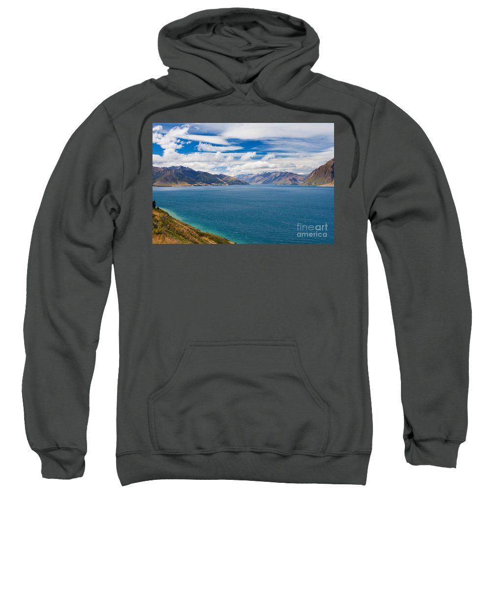 South Island Sweatshirt featuring the photograph Blue Surface Of Lake Hawea In Central Otago Of New Zealand by Stephan Pietzko