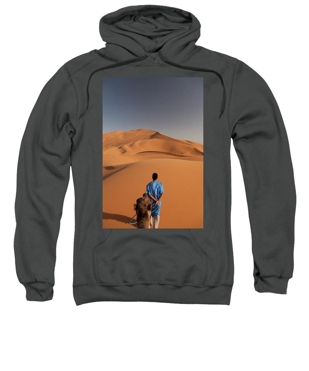Arid Climate Sweatshirt featuring the photograph Camels In Sahara Desert. Erg Chebbi by Mauro Ladu