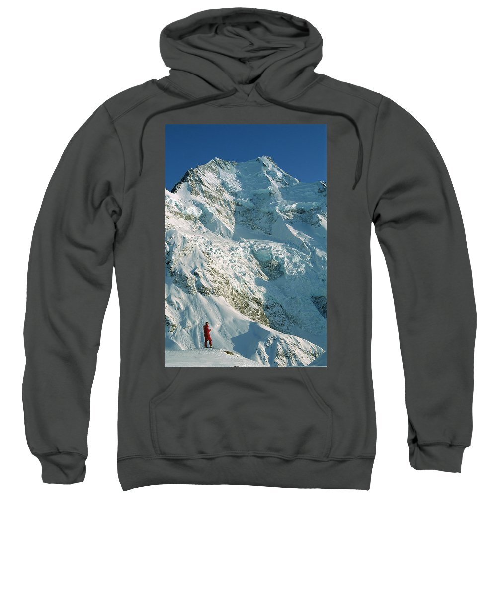 Ball Pass Sweatshirt featuring the photograph Climber Enjoying View Of Mt Cook by Colin Monteath
