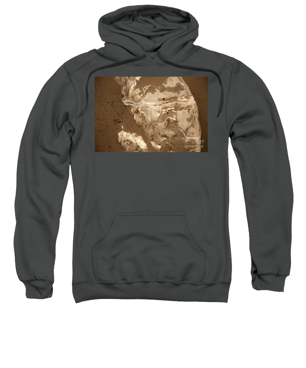 close Up Of Rocks In Sand Sweatshirt featuring the photograph Facing The Past by Amanda Barcon