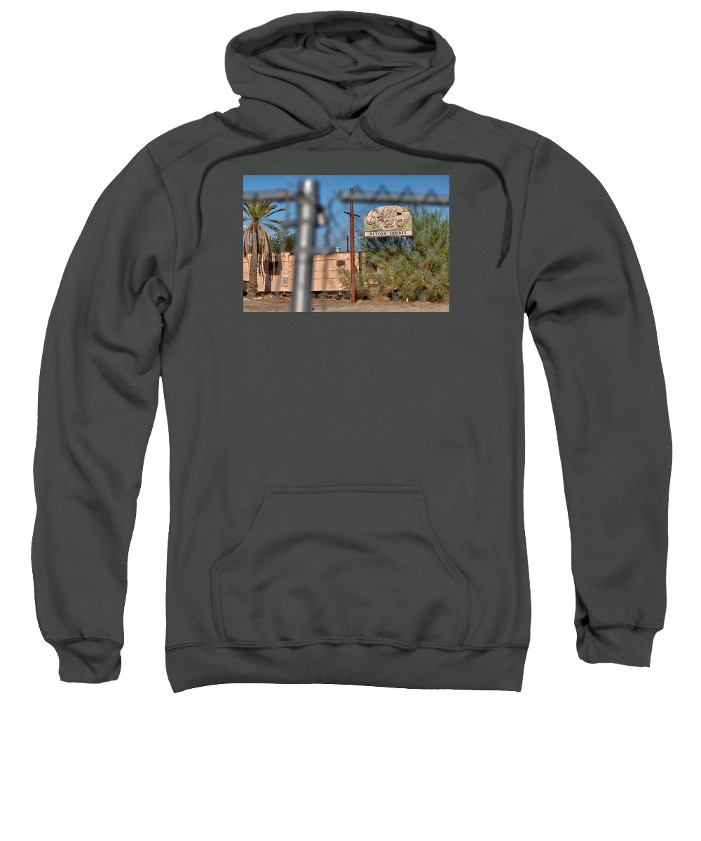 Salton Sea Sweatshirt featuring the photograph Fenced In Abandoned 1950's Motel Trailer by Scott Campbell