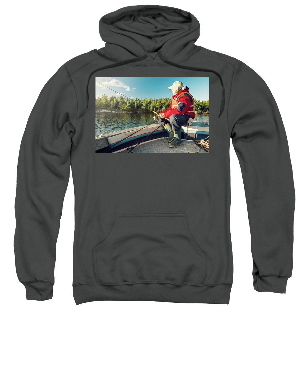 Hobbies Sweatshirt featuring the photograph Fisherman Sitting On Foredeck by Marko Radovanovic