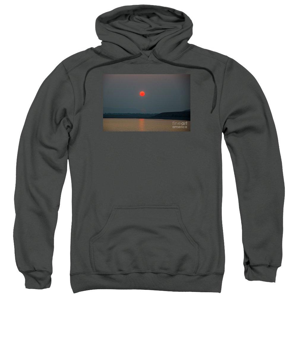 Sunset Sweatshirt featuring the photograph Hanging Sun by Robert Bales