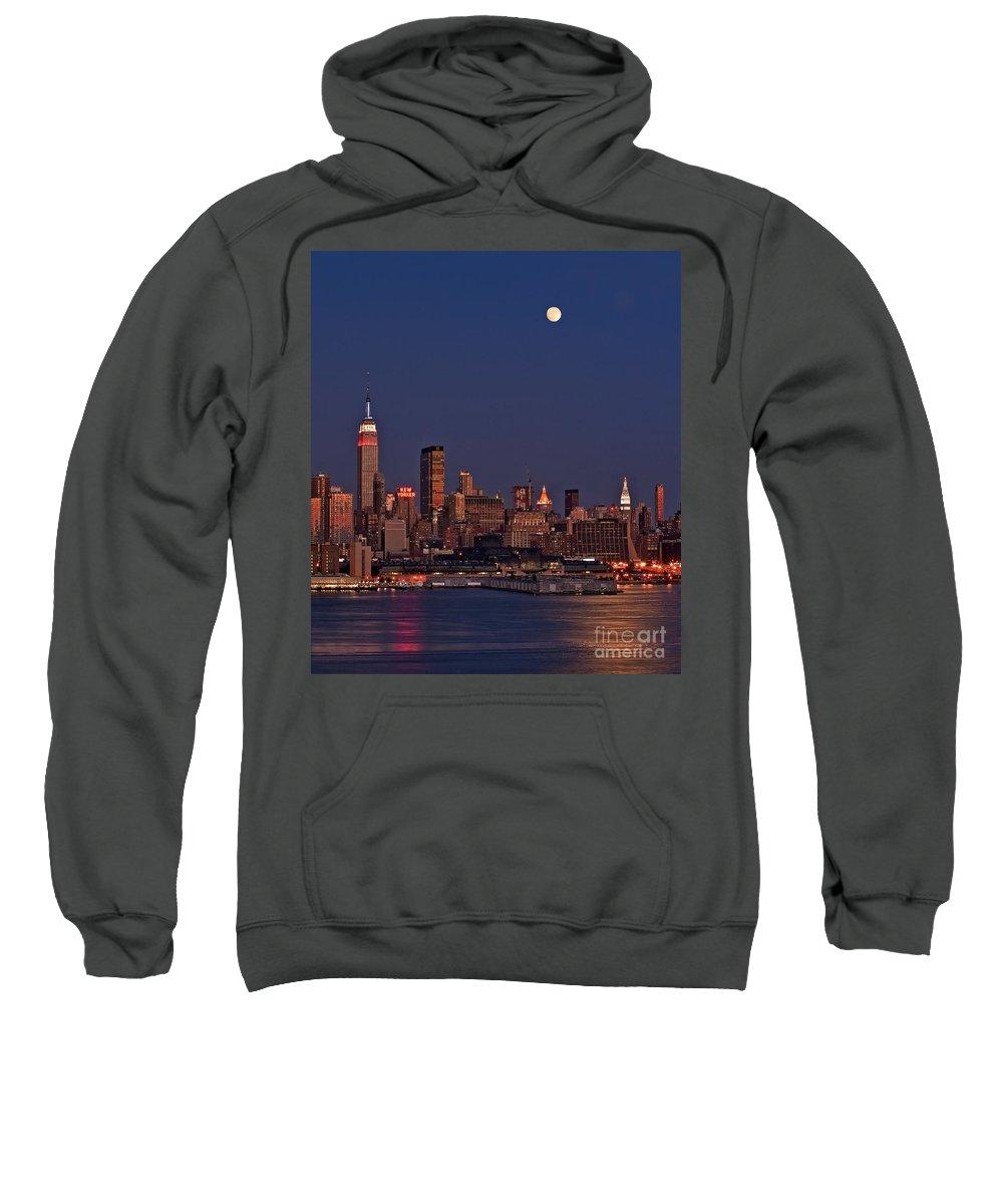 New York City Skyline Sweatshirt featuring the photograph Moon Rise Over Manhattan by Susan Candelario
