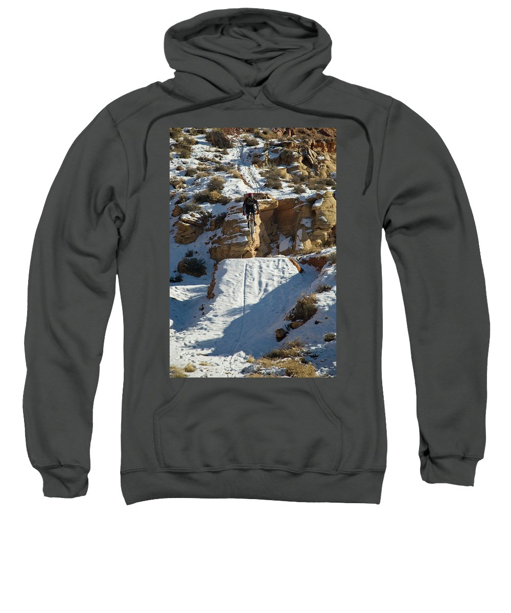 Action Sweatshirt featuring the photograph Mountain Biker Jumping With Snowy by Whit Richardson