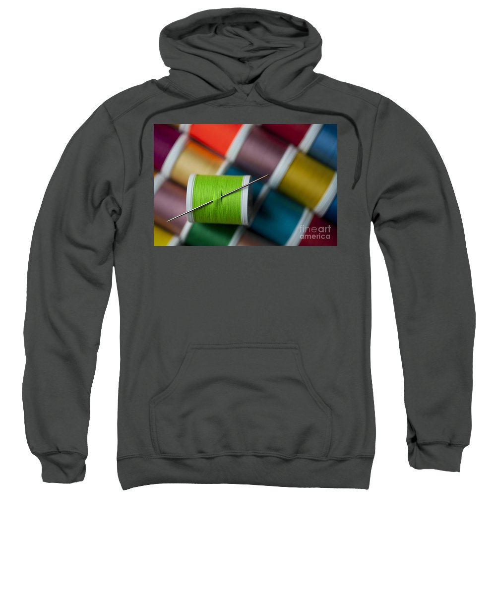 Abundance Sweatshirt featuring the photograph Sewing Needle With Bright Colored Spools by Jim Corwin