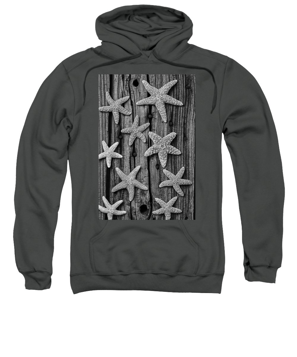 Starfish Sweatshirt featuring the photograph Starfish On Old Wood Black And White by Garry Gay
