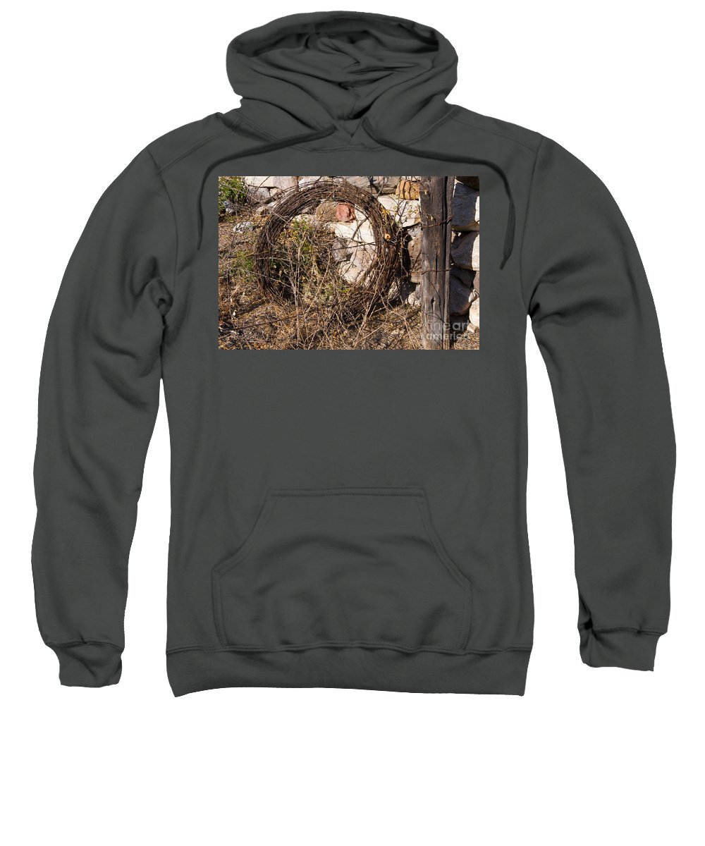 Big Bend Ranch State Park Texas Park Barbed Wire Roll Fence Post Rock Rocks Ranches Sweatshirt featuring the photograph Wire Roll by Bob Phillips