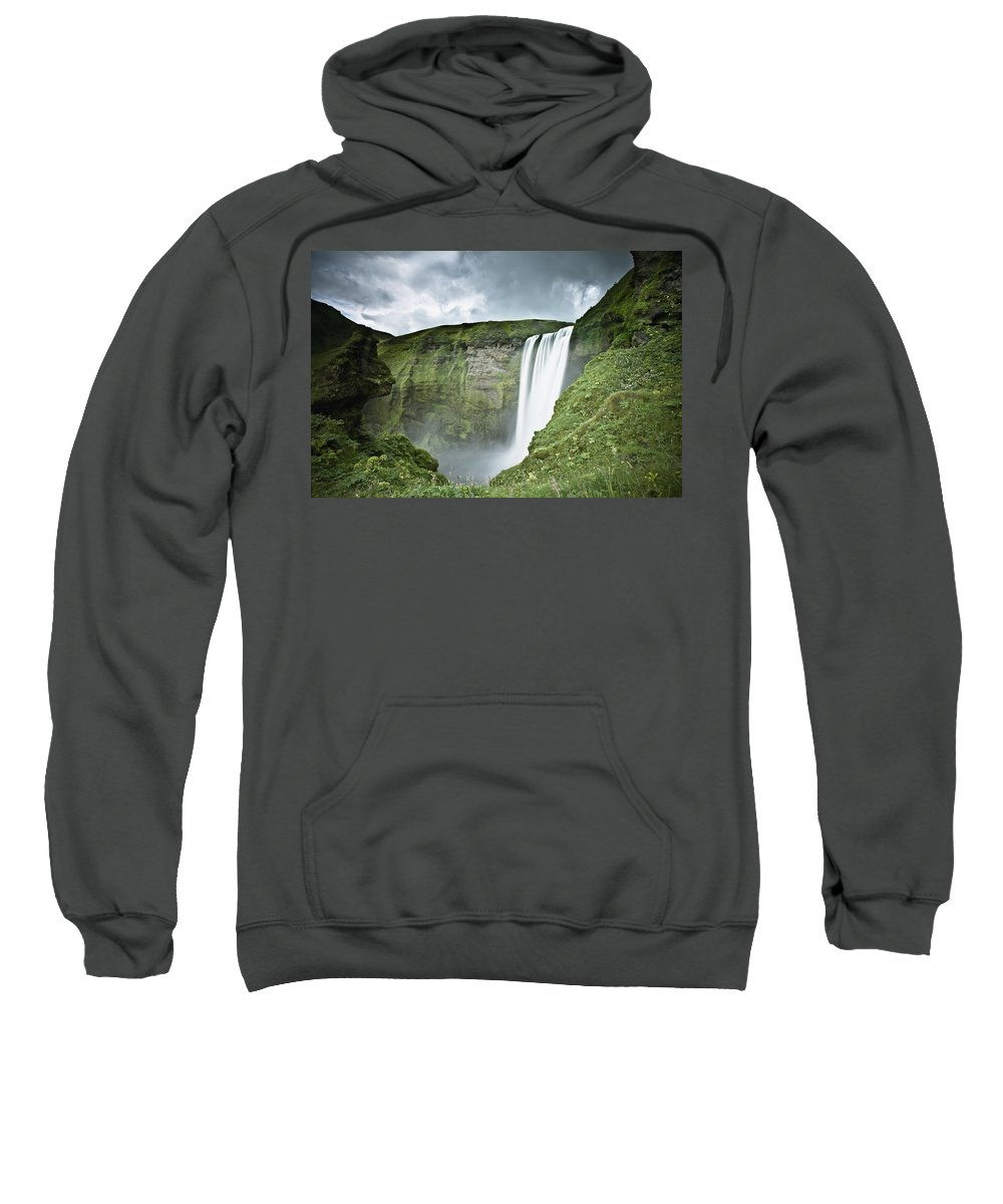Blurred Motion Sweatshirt featuring the photograph A Waterfall Over A Grassy Cliff by David DuChemin
