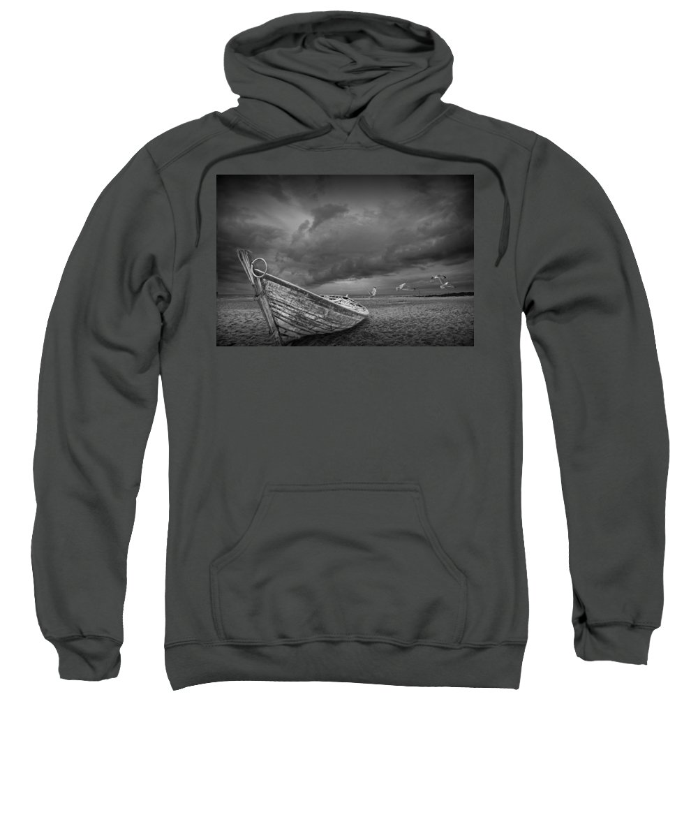 Art Sweatshirt featuring the photograph Boat Stranded On A Beach Covered By Menacing Storm Clouds by Randall Nyhof