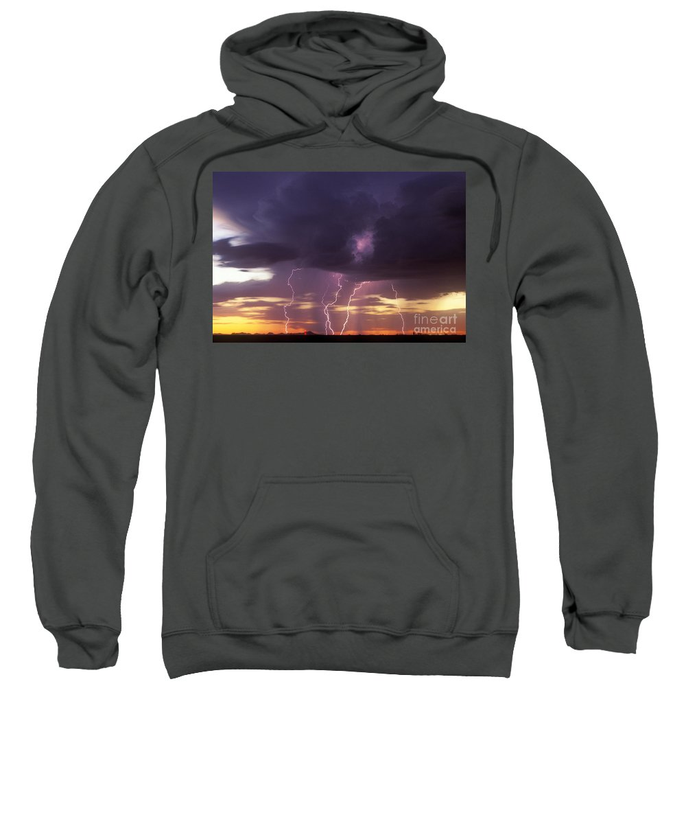 Rain Sweatshirt featuring the photograph Cloud To Ground Lightning At Sunset by John A Ey III and Photo Researchers
