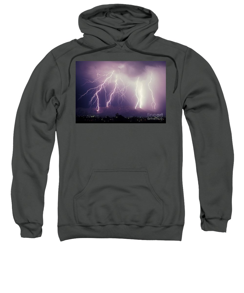 Storms Sweatshirt featuring the photograph Cloud To Ground Lightning by John A Ey III and Photo Researchers