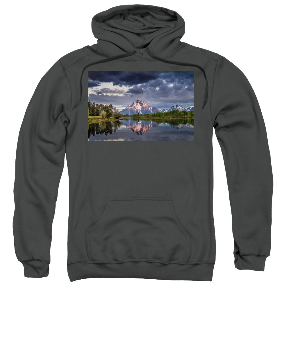 Grand Tetons National Park Sweatshirt featuring the photograph Darkening Skies Over Oxbow Bend by Greg Nyquist