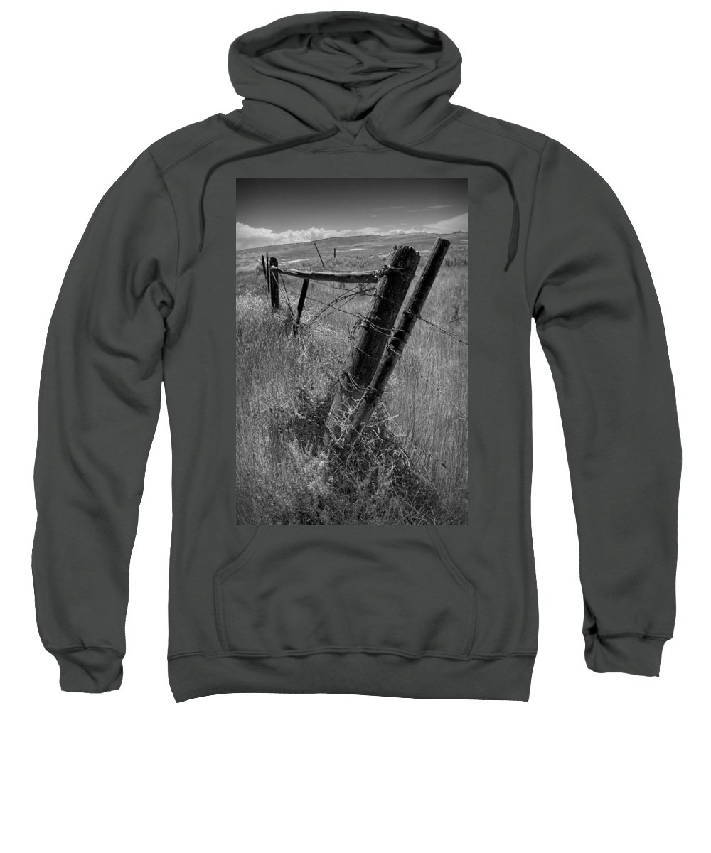 Art Sweatshirt featuring the photograph Fence Posts And Barbed Wire At The Edge Of A Field In Montana by Randall Nyhof