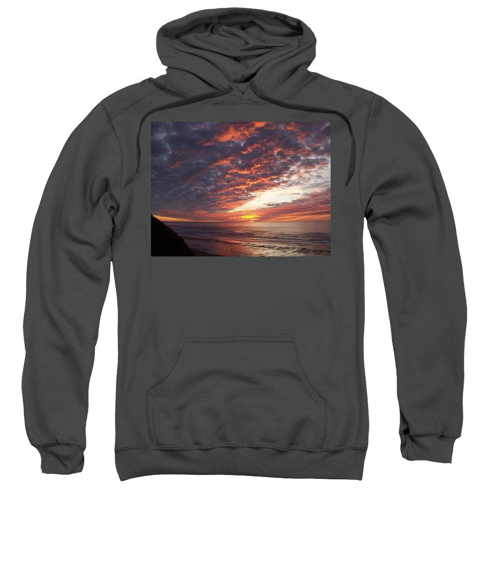 Oregon Sunset Sweatshirt featuring the photograph Lincoln City Sunset by John McManus