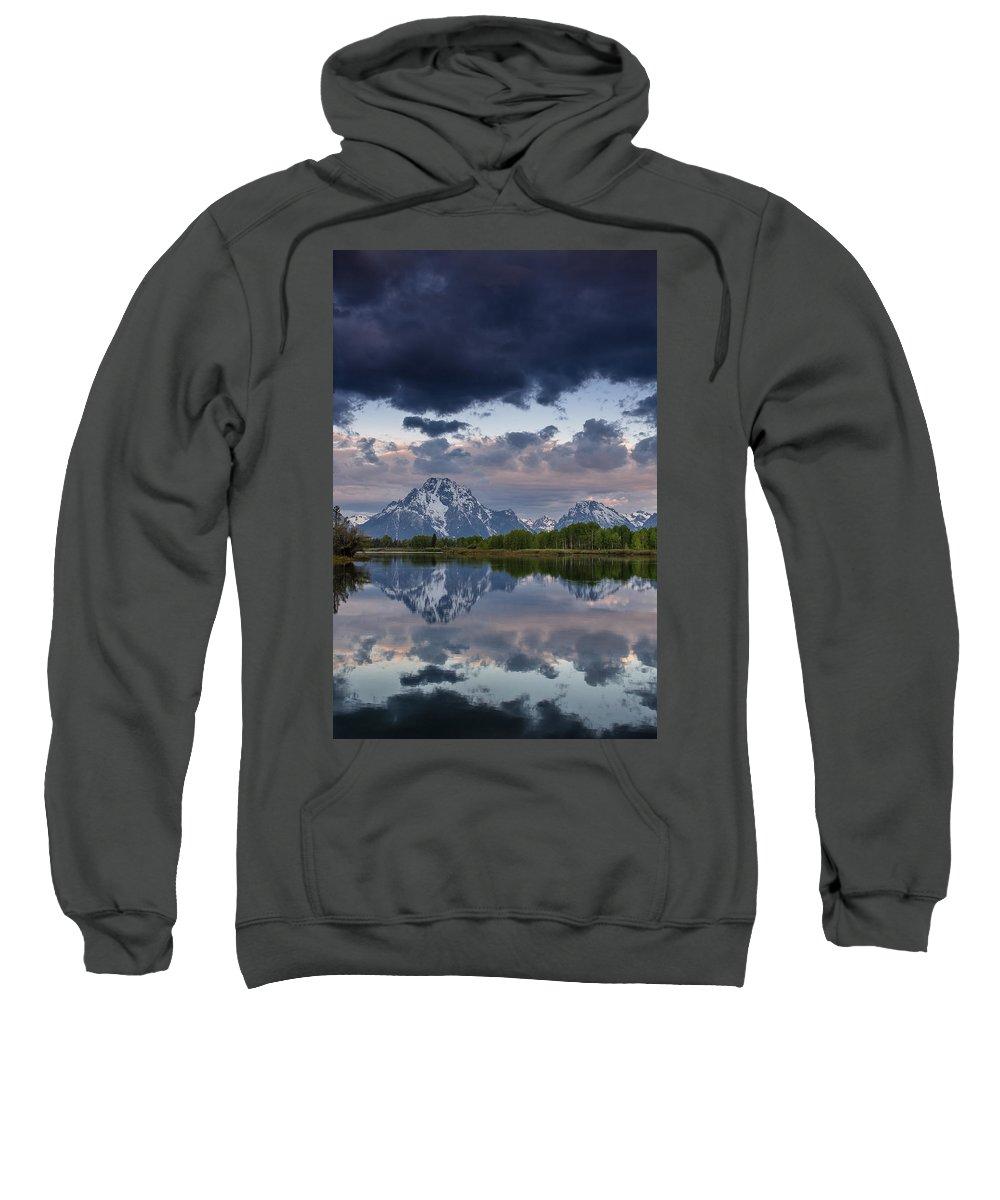 Grand Tetons National Park Sweatshirt featuring the photograph Mount Moran Under Black Cloud by Greg Nyquist