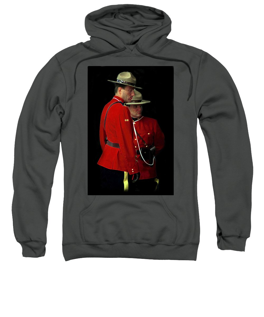 R.c.m.p. Sweatshirt featuring the photograph Painted Mounties by Andrew Fare