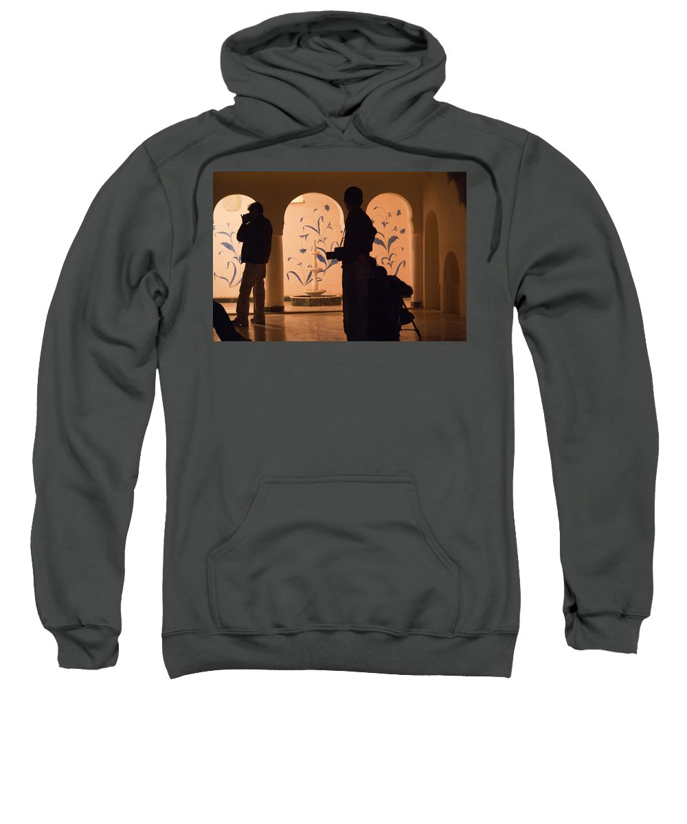 Person Sweatshirt featuring the photograph Photographers In Silhouette At A Heritage Building In Rajasthan In India by Ashish Agarwal
