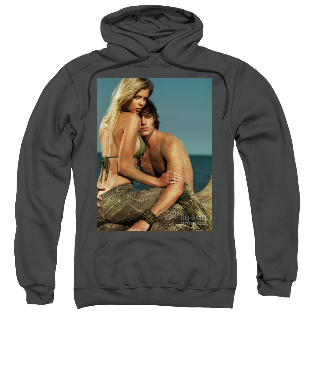 Couple Sweatshirt featuring the photograph Sensual Portrait Of A Young Couple On The Beach by Oleksiy Maksymenko