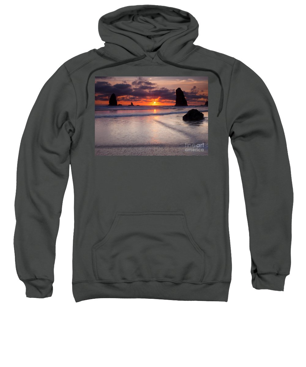 Cannon Beach Sweatshirt featuring the photograph Setting Between The Needles by Mike Dawson