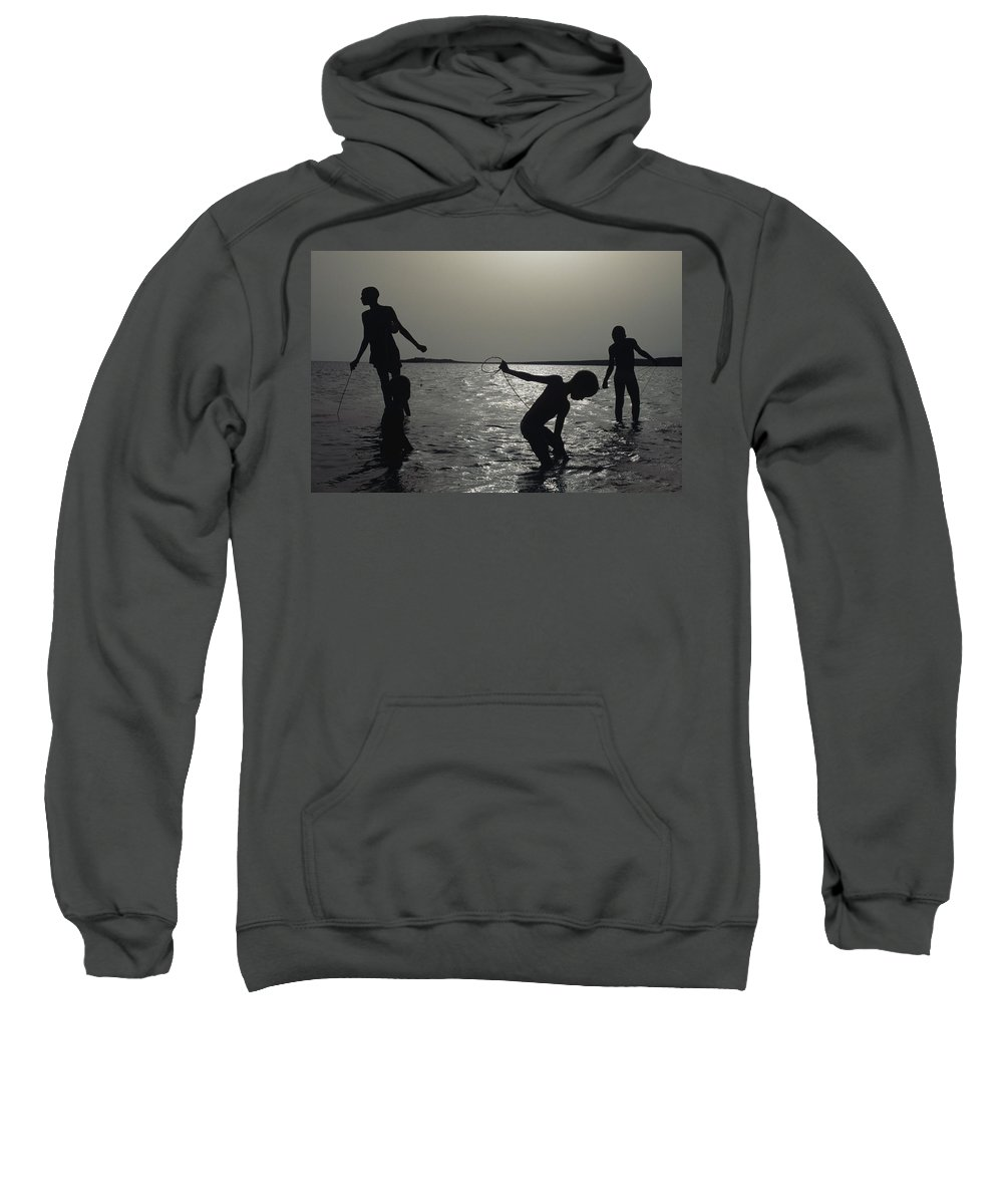 Color Image Sweatshirt featuring the photograph Silhouette Of Boys Fishing by Axiom Photographic