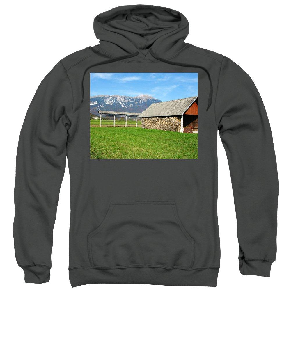 Slovenian Hayrack Sweatshirt featuring the photograph Slovenian Hayrack And Woodpile by Greg Matchick