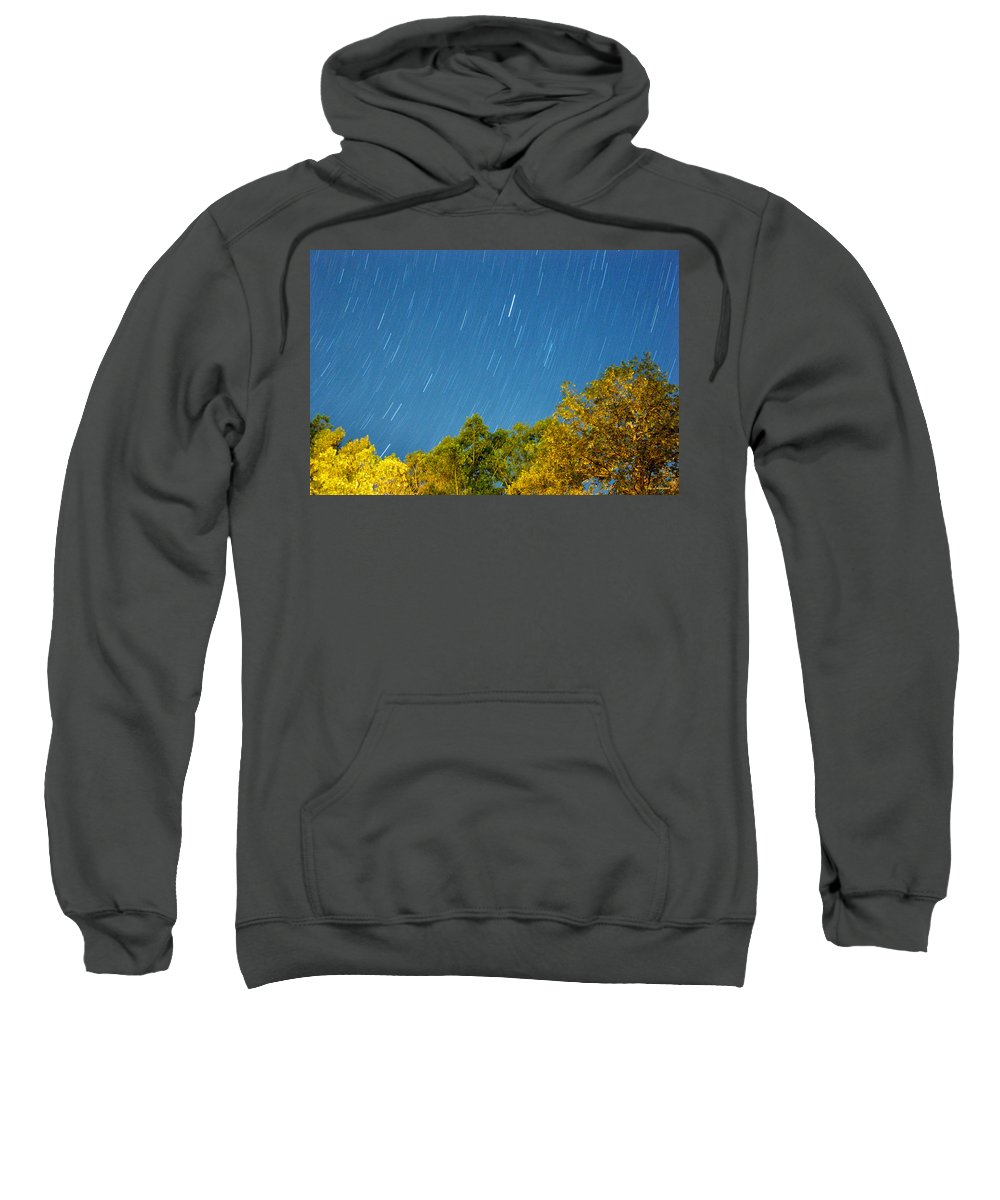 Night Sweatshirt featuring the photograph Star Trails On A Blue Sky by Kay Lovingood