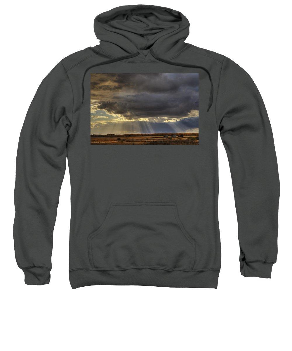 Alberta Sweatshirt featuring the photograph Sun Rays Through Clouds Over Three Old by Dan Jurak