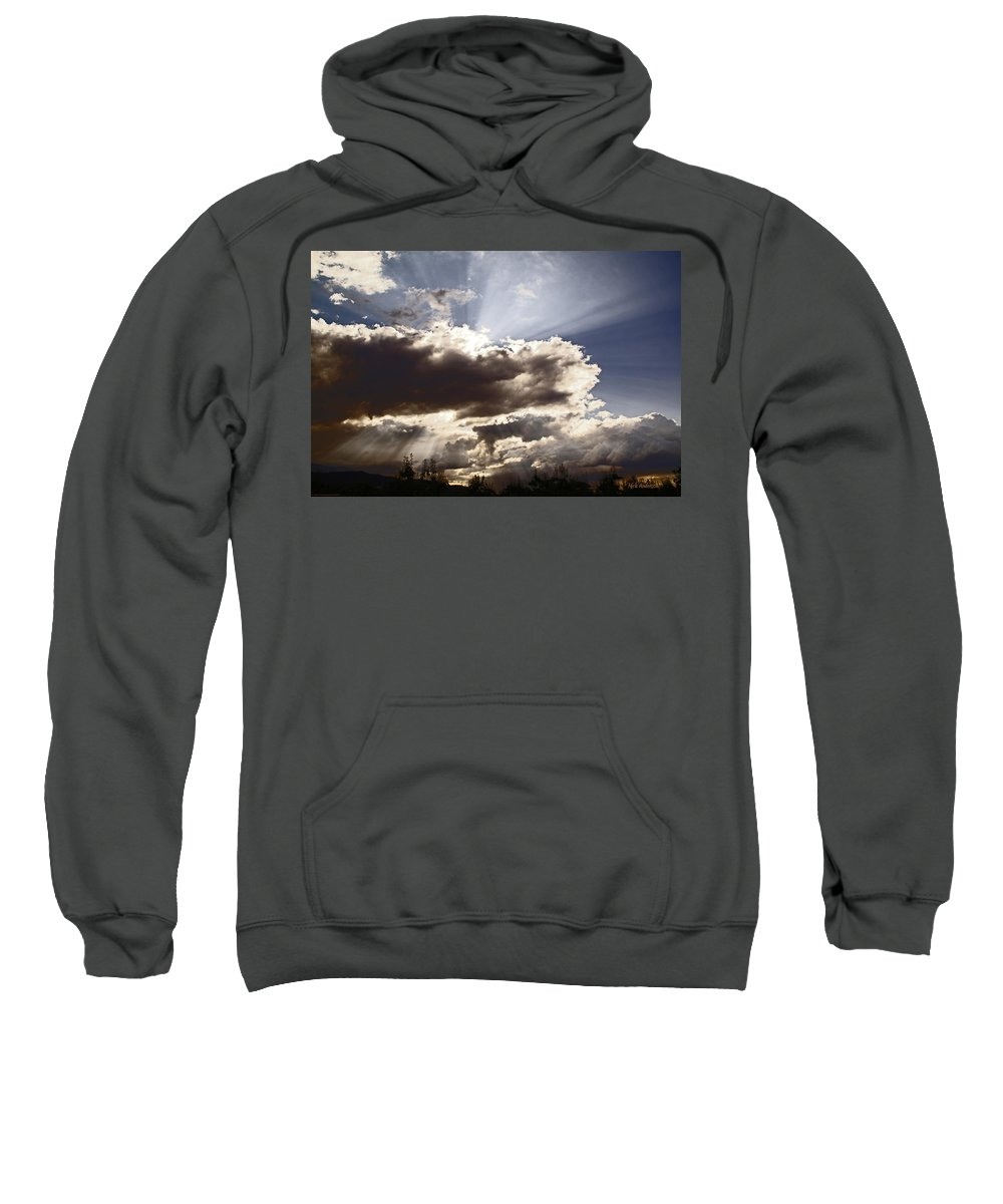 Sunlight Sweatshirt featuring the photograph Sunlight And Stormy Skies by Mick Anderson