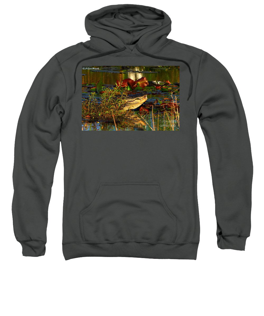 American Alligator Sweatshirt featuring the photograph What Lurks On The Swamp by Barbara Bowen