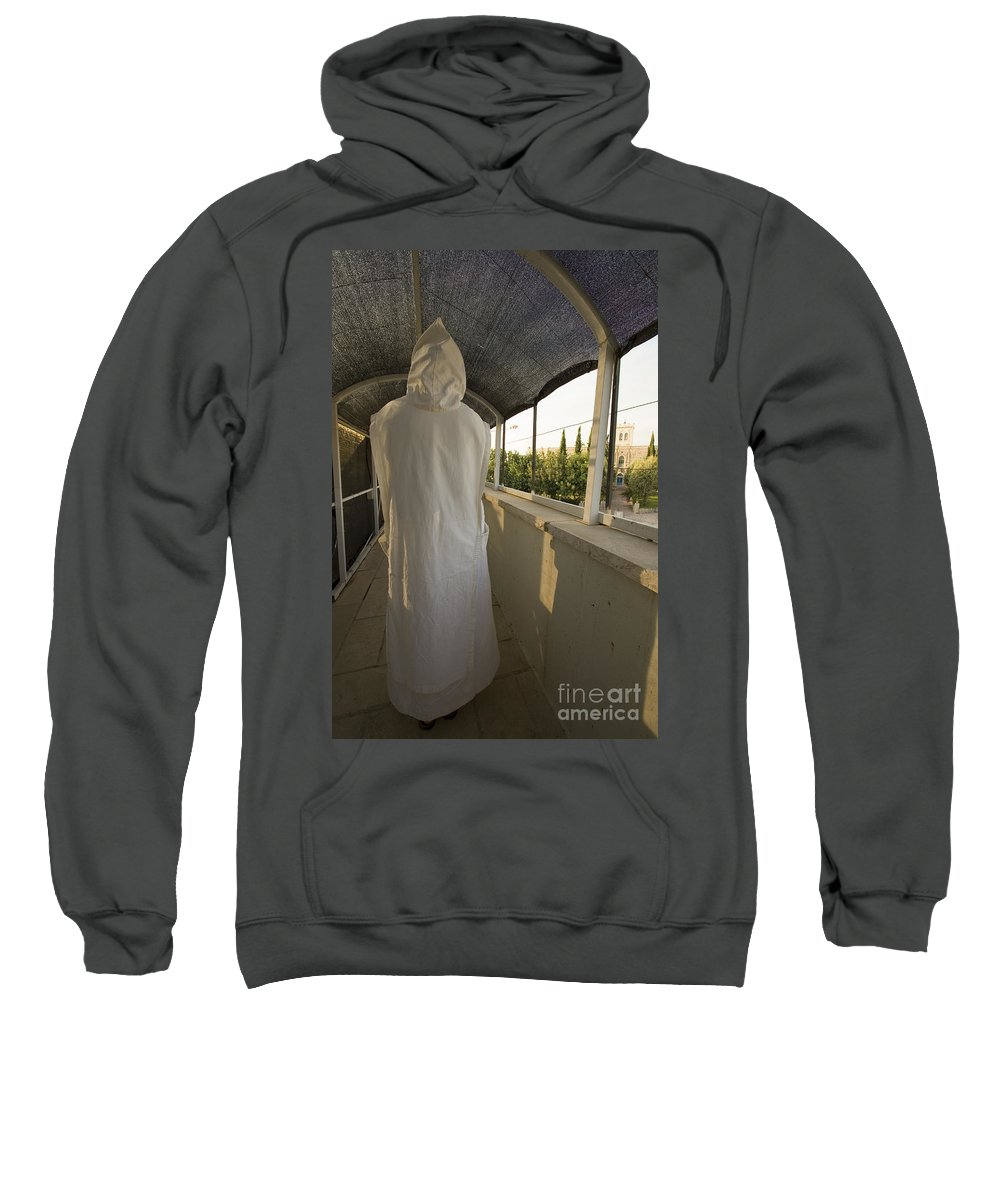 Nun Sweatshirt featuring the photograph A Nun In A Monastery by Danny Yanai