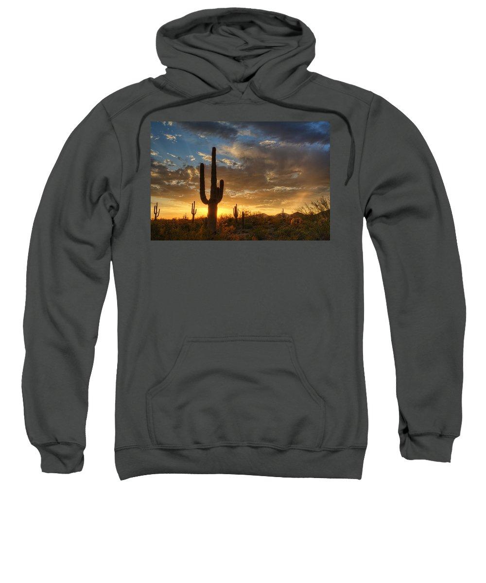 Saguaro Sunset Sweatshirt featuring the photograph A Serene Sunset In The Sonoran Desert by Saija Lehtonen