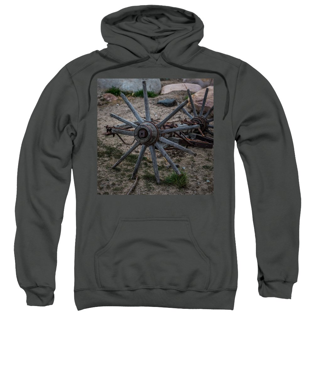 Antique Wagon Wheel Sweatshirt featuring the photograph Antique Wagon Wheel by Paul Freidlund