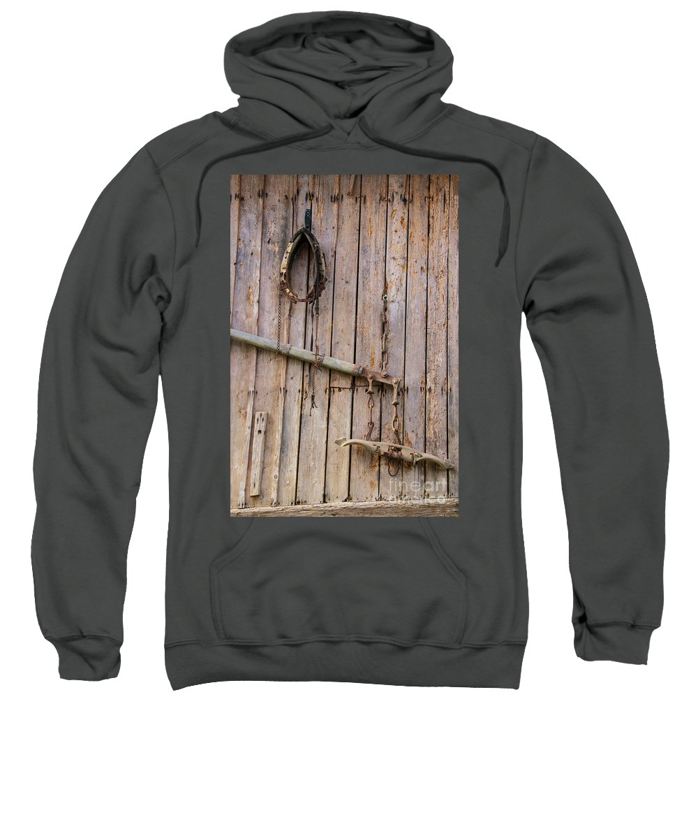 Austria Barn Door Barns Doors Wood Texture Textures Farm Implement Farms Implements Sweatshirt featuring the photograph Austrian Barn Door by Bob Phillips