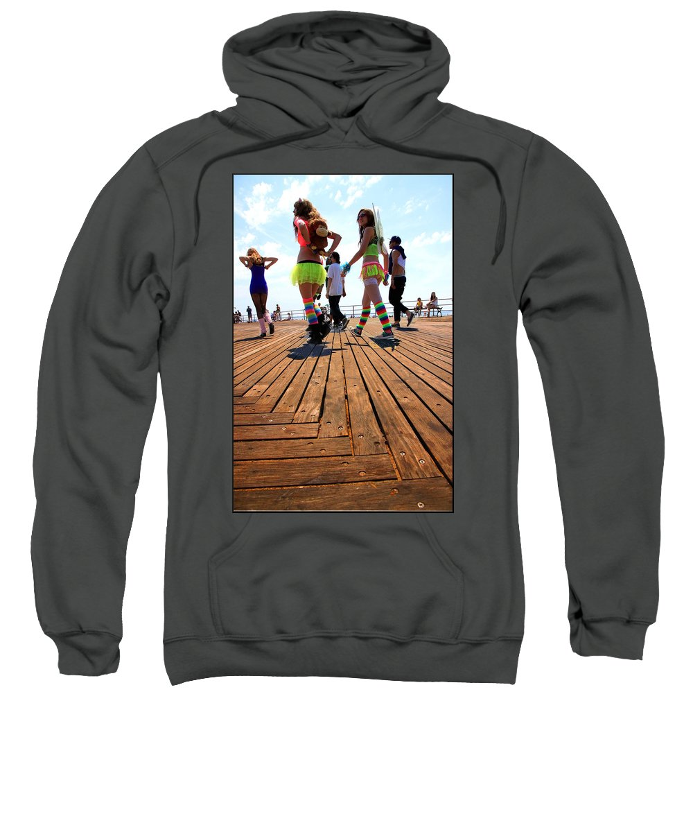 Coney Sweatshirt featuring the photograph Coney Island Encounters by Valentino Visentini
