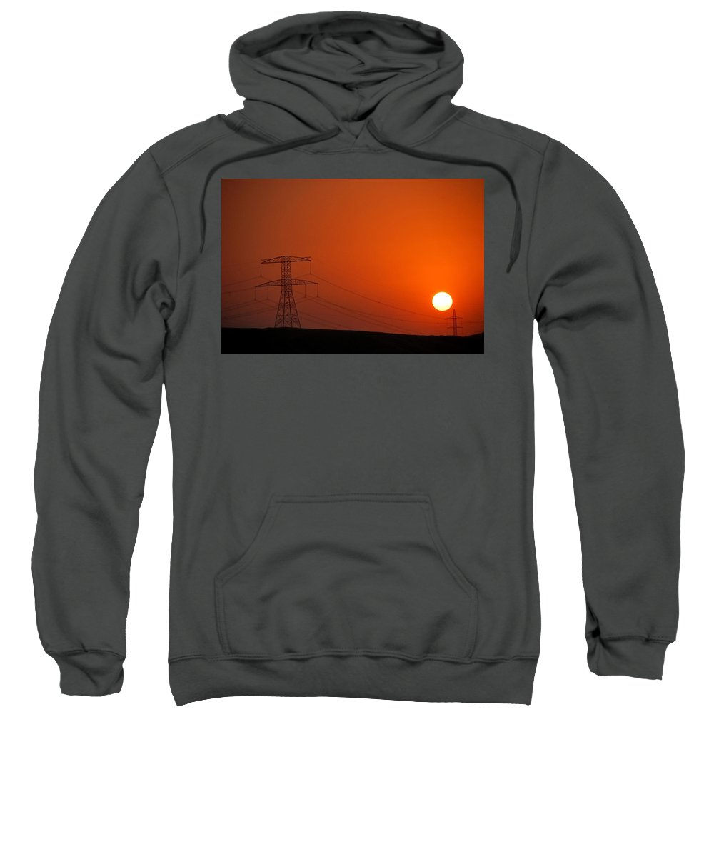 A Sunset Featuring The Sun The Eternal Source Of Energy Bestowing Its Light Upon Man-made Contraption Of Energy-the Power Transmission Grid Taken Outside Of Dubai Sweatshirt featuring the photograph Desert Sunset by Apurva Madia