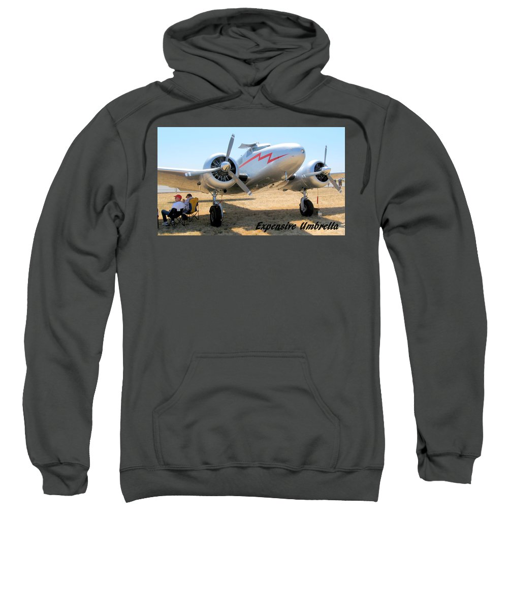 Airplane Sweatshirt featuring the photograph Expensive Umbrella by Thomas Sexton
