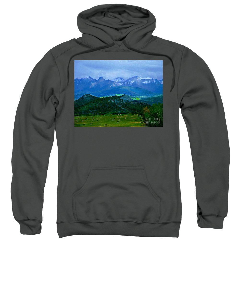 Blues And Greens Show Off This Mysterious And Peaceful Colorado Scene Of Hay Fields And Majestic Mountains. Sweatshirt featuring the digital art Fall Before The San Juans by Annie Gibbons